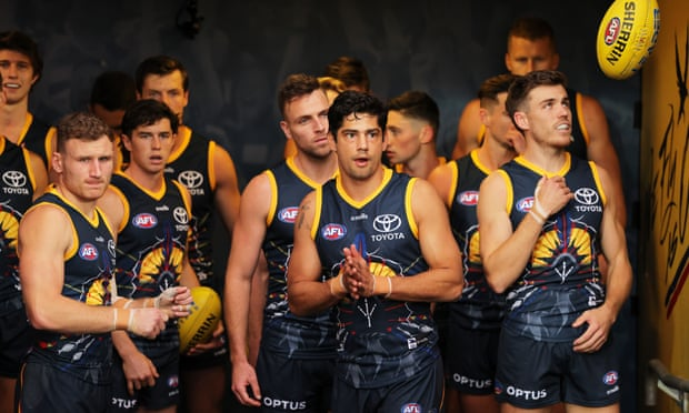 Adelaide Crows fined $50k over mask-wearing error on flight home